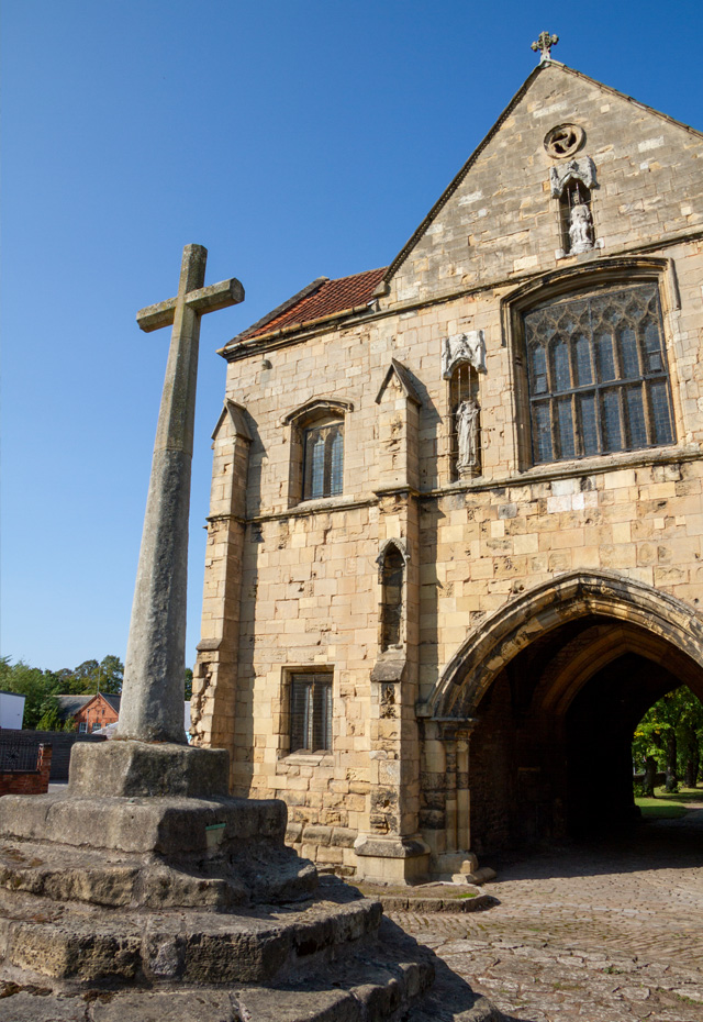 Worksop Priory Gatehouse and relocated marketplace cross